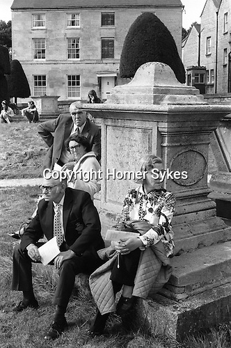 Painswick Clypping church service Gloucestershire Uk 1973. Visitors sit and watch amongst the tomb stones