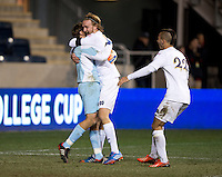 Patrick Wall (1) of Notre Dame celebrates with teammates Grant Van De Casteele (20) after the NCAA Men's College Cup final at PPL Park in Chester, PA.  Notre Dame defeated Maryland, 2-1.