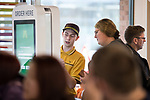 © Joel Goodman - 07973 332324 . 14/08/2015 . Hyde , UK . Staff showing customers how to use McDonalds' new order screen and waited table service at their branch in Mottram , Hyde . Photo credit : Joel Goodman