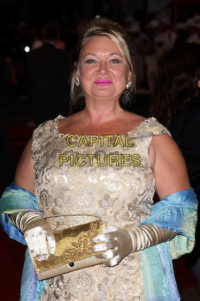 "NICOLA DUFFET.""Made In Dagenham"" UK film premiere held at the Odeon Leicester Square,  London, England, 20th September 2010..half length gold clutch bag cream dress gloves blue wrap shawl shiny patterned.CAP/AH.©Adam Houghton/Capital Pictures."