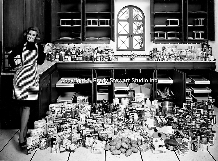 Client: Rubbermaid<br /> Ad Agency: Ketchum, MacLeod &amp; Grove<br /> Product: Rubbermaid Kitchen Products<br /> Contact: Mr. Kaesmeier KM&amp;G<br /> Location: Brady Stewart Studio, 725 Liberty Avenue Pittsburgh<br /> <br /> View of a housewife getting ready to organize her kitchen with new Rubbermaid Products.  Founded in 1920 in Wooster Ohio, Rubbermaid has been a global leader in manufacturing and distributing household goods.