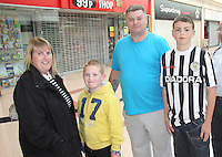 The queue waiting for the strip launch. St Mirren manager Danny Lennon along with Marc McAusland, Jim Goodwin and Sam Parkin celebrating the launch of the new black away kit, featuring a diagonal red stripe across the shirt at JD Sports, Paisley on 12.9.12.
