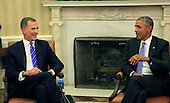 United States President Barack Obama, right, holds a bilateral meeting with King Felipe VI of Spain, left, in the Oval Office of the White House in Washington, DC on Tuesday, September 15, 2015.<br /> Credit: Dennis Brack / Pool via CNP