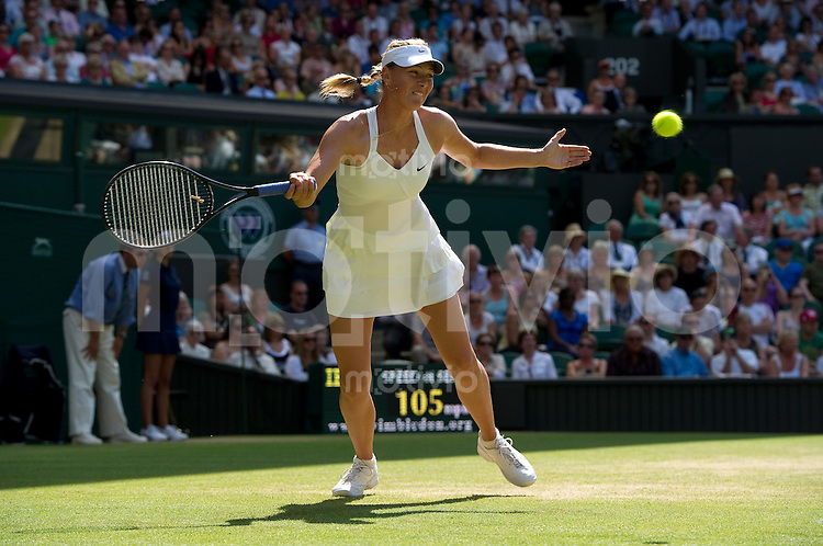 Maria Sharapova (RUS) plays against Serena Williams (USA) on Centre Court. The Wimbledon Championships 2010 The All England Lawn Tennis & Croquet Club  Day 7 Monday 28/06/2010