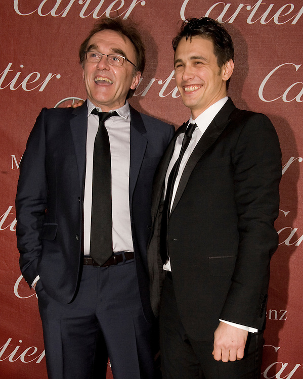 Danny Boyle, left, and James Franco share a laugh in front of the cameras during the Palm Springs International Film Festival red carpet prior to Boyle being awarded the Sonny Bono Visionary Award at the Palm Springs Convention Center on Saturday.