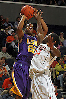 Jan. 2, 2011; Charlottesville, VA, USA; LSU Tigers guard Ralston Turner (22) shoots over Virginia Cavaliers guard K.T. Harrell (24) during the game at the John Paul Jones Arena. Mandatory Credit: Andrew Shurtleff