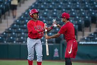 AZL Angels left fielder Datren Bray (16) is congratulated by a teammate after scoring a run during an Arizona League game against the AZL Indians 2 at Tempe Diablo Stadium on June 30, 2018 in Tempe, Arizona. The AZL Indians 2 defeated the AZL Angels by a score of 13-8. (Zachary Lucy/Four Seam Images)