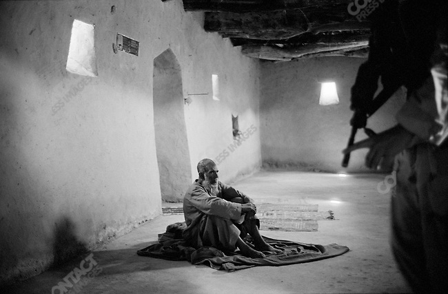 Lft. Eric Nelson of 1st Battalion, 508th Infantry Regiment of the 173rd Airborne Brigade comes across a Mullah inside a Mosque in the village of Gonbaz, Shawali-Kot, Kandahar Province on a Taliban search. October 2005.