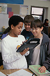 Berkeley, CA  Students in fifth grade class doing writing together on Alphasmart word processing machine