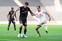 Lincoln City's Conor McGrandles vies for possession with Milton Keynes Dons' Callum Brittain<br /> <br /> Photographer Chris Vaughan/CameraSport<br /> <br /> The EFL Sky Bet League One - Milton Keynes Dons v Lincoln City - Saturday 19th September 2020 - Stadium MK - Milton Keynes<br /> <br /> World Copyright © 2020 CameraSport. All rights reserved. 43 Linden Ave. Countesthorpe. Leicester. England. LE8 5PG - Tel: +44 (0) 116 277 4147 - admin@camerasport.com - www.camerasport.com