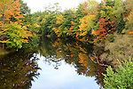 Autumn splendor refleced in a lake. Images of The Canadian Maritime Provinces of Nova Scotia and Prince Edward Island.