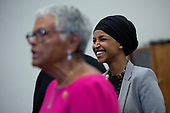 United States Representative Ilhan Omar (Democrat of Minnesota) laughs during a press conference with United States Representative Ayanna Pressley (Democrat of Massachusetts) and United States Representative Bonnie Watson Coleman (Democrat of New Jersey) at the United States Capitol in Washington D.C., U.S., on Thursday, December 5, 2019. <br /> <br /> Photographer: Stefani Reynolds/CNP