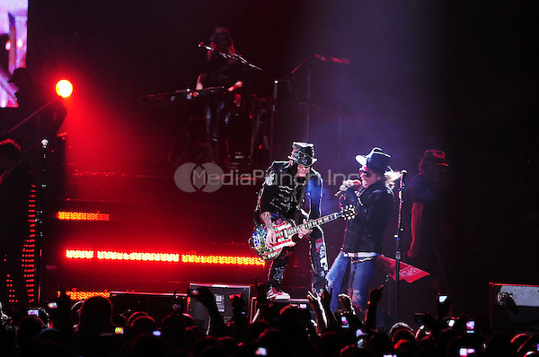 MIAMI BEACH, FL - OCTOBER 29: Guitarist/ songwriter Dj Ashba of Guns N' Roses performs at the American Airlines Arena during his North American Tour on October 29, 2011 in Miami Beach, Florida.  (photo by: MPI10/MediaPunch Inc.)