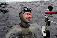Winner of freediving competition Oslo Ice Challenge, Guillaume Néry,  at freshwater lake Lutvann, outside the Norwegian capital Oslo. Atheletes, including current and former world champions, entered a hole in the ice to compete. The participants reached depths down to 52 meters below the surface.