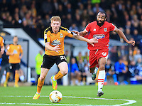 Brad Halliday fends off attack by Dominic Vose during the Sky Bet League 2 match between Cambridge United and Grimsby Town at the R Costings Abbey Stadium, Cambridge, England on 15 October 2016. Photo by PRiME Media Images.