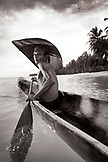INDONESIA, Mentawai Islands, Kandui Resort, portrait of a Mentawai fisherman, Gesayas Ges, in his dugout canoe (B&W)