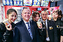 Ned Lyerly (second from left) President, International at CKE Restaurants Holding, Inc. poses for a photograph with members of staff during the pre-opening event for the Japan's first Carl's Jr. burger restaurant located in Tokyo's Akihabara district, on March 2, 2016, Japan. The Californian fast food restaurant follows on the heels of Shake Shack in entering the Japanese market. Mitsuuroko Group Holdings Co., Ltd. has signed a franchise agreement to operate Carl's Jr. branches in Japan with the first to open to the public on March 4th. (Photo by Rodrigo Reyes Marin/AFLO)