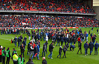 Barnsley fans run onto the pitch after the match<br /> <br /> Photographer Alex Dodd/CameraSport<br /> <br /> The EFL Sky Bet League One - Barnsley v Blackpool - Saturday 27th April 2019 - Oakwell - Barnsley<br /> <br /> World Copyright © 2019 CameraSport. All rights reserved. 43 Linden Ave. Countesthorpe. Leicester. England. LE8 5PG - Tel: +44 (0) 116 277 4147 - admin@camerasport.com - www.camerasport.com