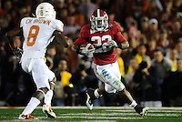 Jan 7, 2010; Pasadena, CA, USA; Alabama Crimson running back Mark Ingram (22) runs with the ball while being defended by the Texas Longhorns during the second quarter of the 2010 BCS national championship game at the Rose Bowl.  Mandatory Credit: Mark J. Rebilas-.