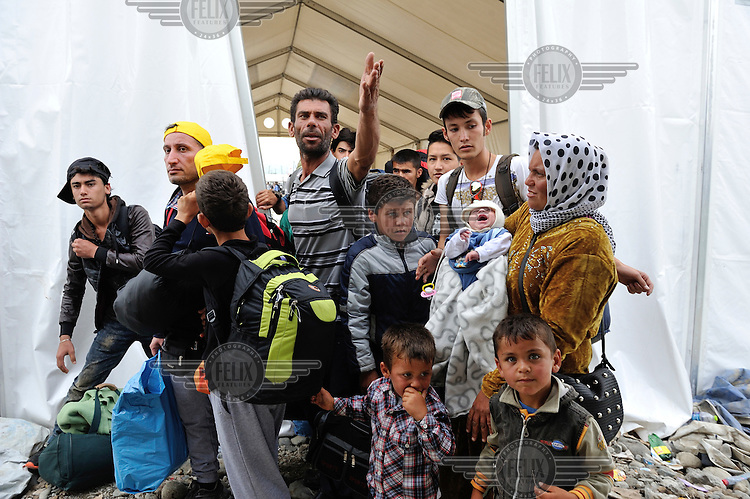 Refugees ask to be able to board a train which will take them to the Serbian border, at Vinojug reception centre in Gevgelija. The center is a kilometer inside the Republic of Macedonia from the Greek border and most refugees and migrants arrive less then 24 hours after leaving the Greek Islands, to which they crossed from Turkey on small boats. /Felix Features