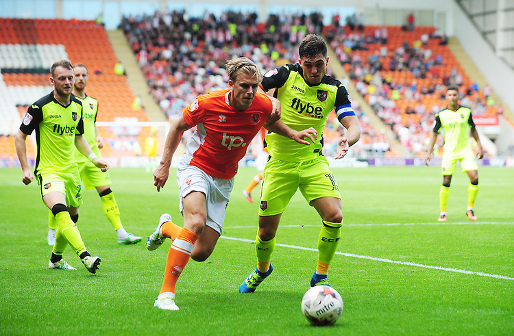 Blackpool's Brad Potts under pressure from Exeter City's Jordan Moore-Taylor<br /> <br /> Photographer Kevin Barnes/CameraSport<br /> <br /> Football - The EFL Sky Bet League Two - Blackpool v Exeter City - Saturday 6th August 2016 - Bloomfield Road - Blackpool<br /> <br /> World Copyright © 2016 CameraSport. All rights reserved. 43 Linden Ave. Countesthorpe. Leicester. England. LE8 5PG - Tel: +44 (0) 116 277 4147 - admin@camerasport.com - www.camerasport.com