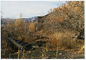 Abandoned RGS right-of-way past coal chute in distance.  Note cattle guard center foreground.<br /> RGS  Ute Junction, CO