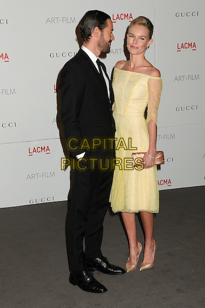Michael Polish and Kate Bosworth.The Inaugural Art and Film Gala held at LACMA in Los Angeles, California, USA..November 5th, 2011.full length yellow dress off the shoulder lace beige clutch bag black suit beard facial hair couple gold shoes profile.CAP/ADM/BP.©Byron Purvis/AdMedia/Capital Pictures.