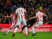 2nd December 2017, bet365 Stadium, Stoke-on-Trent, England; EPL Premier League football, Stoke City versus Swansea City;  Jordan Ayew of Swansea City is surrounded by Stoke City players Darren Fletcher and Joe Allen