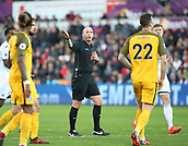 4th November 2017, Liberty Stadium, Swansea, Wales; EPL Premier League football, Swansea City versus Brighton and Hove Albion; Referee Mike Dean awards the corner