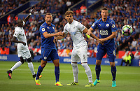 Pictured: Fernando Llorente of Swansea City (C) between Danny Drinkwater (L) and Robert Huth of Leicester City Saturday 27 August 2016<br /> Re: Swansea City FC v Leicester City FC Premier League game at the King Power Stadium, Leicester, England, UK