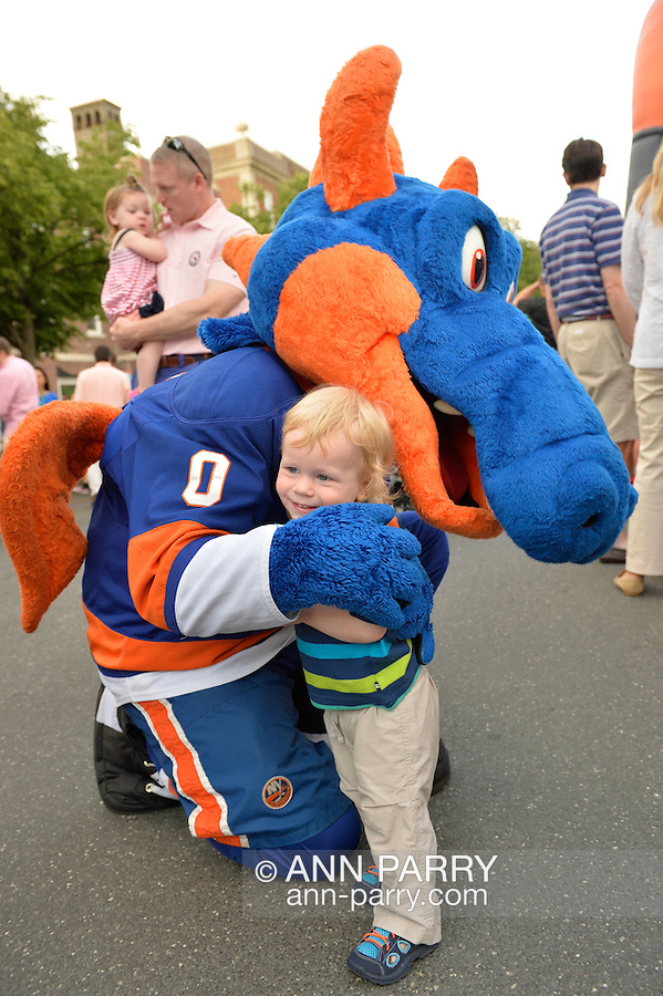 Garden City, New York, U.S. - June 6, 2014 - OLIVER PAPP, 18-months-old, of Garden City, hugs SPARKY THE DRAGON, the New York Islanders mascot, at the 17th Annual  Garden City Belmont Stakes Festival, celebrating the 146th running of Belmont Stakes at nearby Elmont the next day. There was street festival family fun with live bands, food, pony rides and more, and a main sponsor of this Long Island night event was The New York Racing Association Inc.