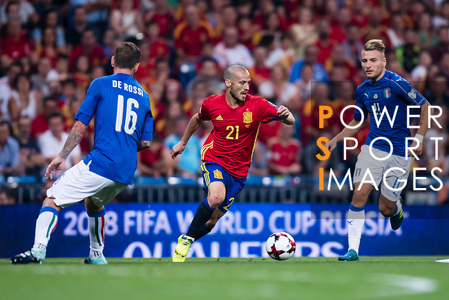 David Silva (C) of Spain fights for the ball with Ciro Immobile (R) and Daniele De Rossi (L) of Italy during their 2018 FIFA World Cup Russia Final Qualification Round 1 Group G match between Spain and Italy on 02 September 2017, at Santiago Bernabeu Stadium, in Madrid, Spain. Photo by Diego Gonzalez / Power Sport Images