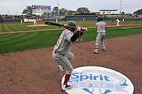 Jeremy Rivera (35) and Luis Alejandro Basabe (5) of the Greenville Drive wait on deck before the first pitch on Thursday, April 14, 2016, opening day at the Columbia Fireflies' new Spirit Communications Park in Columbia, South Carolina. The Mets affiliate moved to Columbia this year from Savannah. Columbia won, 4-1. (Tom Priddy/Four Seam Images)