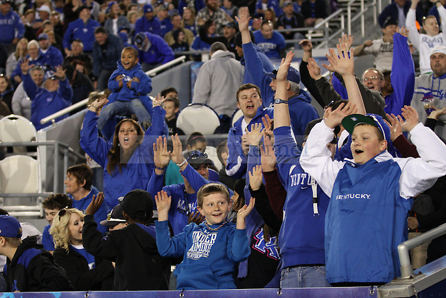 Young Wildcats fans participate in the wave as a loud and energetic crowd showed up in support of the Cats. in Lexington, Ky., on Saturday, April, 13, 2013. Photo by James Holt | Staff