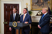 "United States Senator David Perdue (Republican of Georgia) makes an announcement on the introduction of the Reforming American Immigration for a Strong Economy (RAISE) Act in the Roosevelt Room at the White House in Washington, D.C., U.S., on Wednesday, August 2, 2017. The act aims to overhaul U.S. immigration by moving towards a ""merit-based"" system.  Also pictured are US Senator Tom Cotton (Republican of Arkansas), left, and US President Donald J. Trump, right. <br /> Credit: Zach Gibson / Pool via CNP"