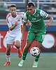 Juan Arango No. 18 of the New York Cosmos, right, gets looks to move a ball upfield during an NASL match against the Carolina RailHawks at Hoftra University on Saturday, Aug. 27, 2016. He scored the first two Cosmos goals and was named Man of the Match in the club's 6-1 win.