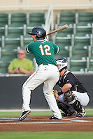 Yefri Perez (12) of the Greensboro Grasshoppers at bat against the Kannapolis Intimidators at CMC-Northeast Stadium on June 12, 2014 in Kannapolis, North Carolina.  The Grasshoppers defeated the Intimidators 5-2.  (Brian Westerholt/Four Seam Images)