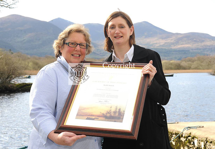 Grainne Gallen, Fexco , with Paddy Patrick from New Zealand and her Irish Heritage certificate  at Ross Castle Killarney.  Picture: MacMonagle, Killarney.