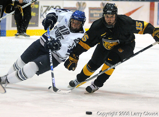 28 November 2008:  Air Force defender, Scott Mathis (23) and Colorado College's Nate Prosser (15) battle during 3rd period action as #11 Air Force upsets #3 Colorado College 4-1at Cadet Ice Arena, United States Air Force Academy, Colorado Springs, CO.