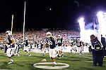 Nevada enters the field before the first half of an NCAA college football game against Boise State in Reno, Nev, on Saturday, Oct. 4, 2014. (AP Photo/Cathleen Allison)