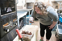 NWA Democrat-Gazette/CHARLIE KAIJO Alicia Rosebeary of Rogers takes a video of live crawfish, Sunday, April 15, 2018 at the Boar's Nest in Rogers. <br />