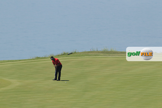 Thongchai Jaidee (THA) putts on the 15th green during Sunday Morning's Semi Finals of the 2013 Volvo World Matchplay Championship held  at the Thracian Cliffs Golf & Beach Resort, Kavarna, Bulgaria, 19th May 2013..Picture: Eoin Clarke www.golffile.ie.