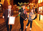 World-renowned traditional musician Liam O'Connor who was  honoured as Killarney's first ambassador at a special function  at  the Killarney Town Council Chambers. Pictured with Liam on Main Street, Killarney is his son Oisin and Mayor of Killarney Donal Grady. Picture: Eamonn Keogh (MacMonagle, Killarney)