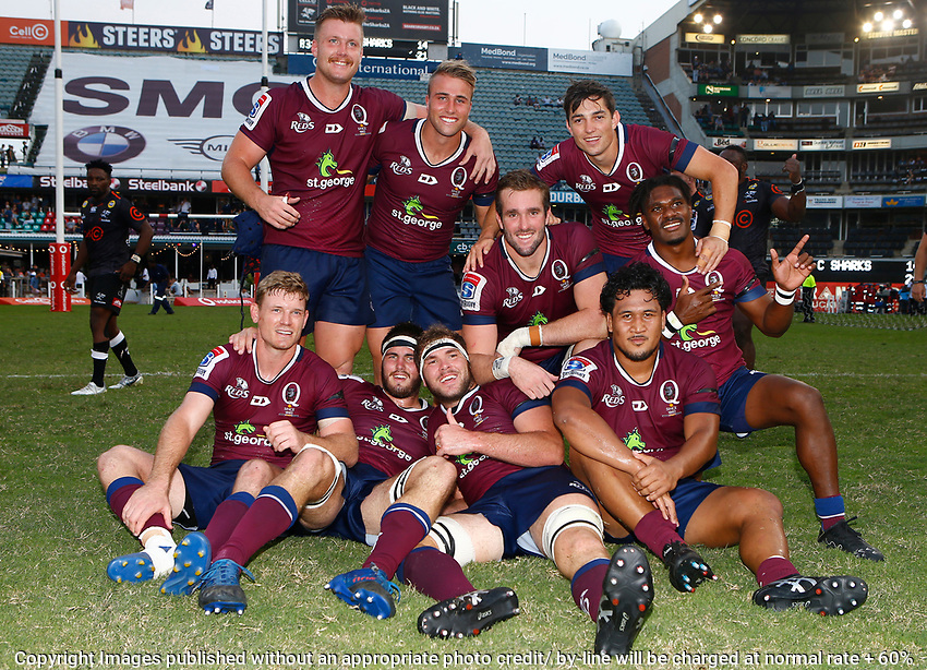 The Queensland Reds pose for a group photo during the super rugby match between the Cell C Sharks and the Queensland Reds at Jonsson Kings Park Stadium in Durban, South Africa 19th April 2019. Photo: Steve Haag / stevehaagsports.com