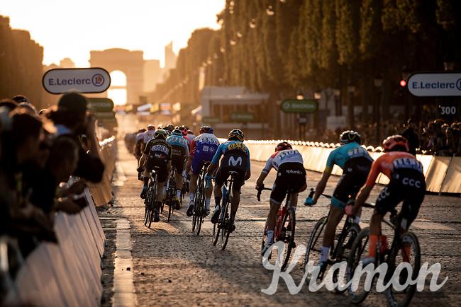 Peloton riding the Champs-Elysées cobbles.<br /> <br /> Stage 21: Rambouillet to Paris (128km)<br /> 106th Tour de France 2019 (2.UWT)<br /> <br /> ©kramon