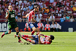 Atletico de Madrid's Juanfran Torres (L) and Jose Maria Gimenez (R) and SD Eibar's Pablo de Blasis during La Liga match. September 15, 2018. (ALTERPHOTOS/A. Perez Meca)