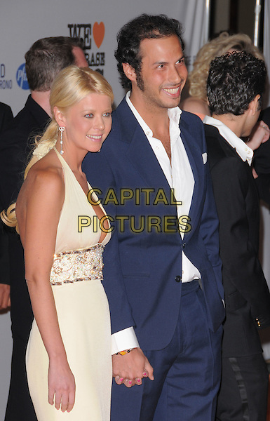 TARA REID & GUEST .Attending The 15th Annual Race to Erase MS Fundraiser held at The The Hyatt Regency Century Plaza Hotel in Century City, California, USA,.May 02 2008..half length holding hands halterneck yellow dress .CAP/DVS.©Debbie VanStory/Capital Pictures