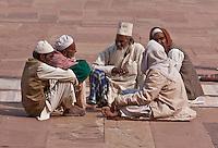 Fatehpur Sikri, Uttar Pradesh, India.  Men Sitting, Talking, in Courtyard of Jama Masjid (Dargah Mosque).