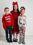 WATERBURY, CT-120218JS01- Christmas Kids, Cousins, from left, T J Brown, 5, Joleeza Hulse,7, and Alani Taylor, 5, all of Waterbury.<br />  Jim Shannon Republican American