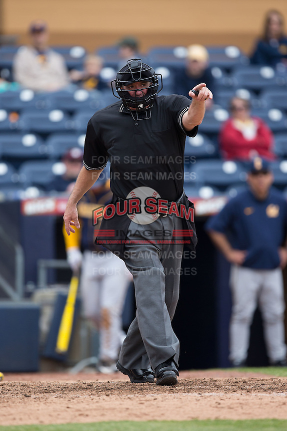 Home plate umpire Reid Churchhill points towards first base after a California Golden Bears batter was hit by a pitch during the game against the Duke Blue Devils at Durham Bulls Athletic Park on February 20, 2016 in Durham, North Carolina.  The Blue Devils defeated the Golden Bears 6-5 in 10 innings.  (Brian Westerholt/Four Seam Images)